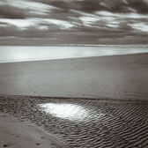 wet-spot-on-beach-13x13-reflective-scan.jpg